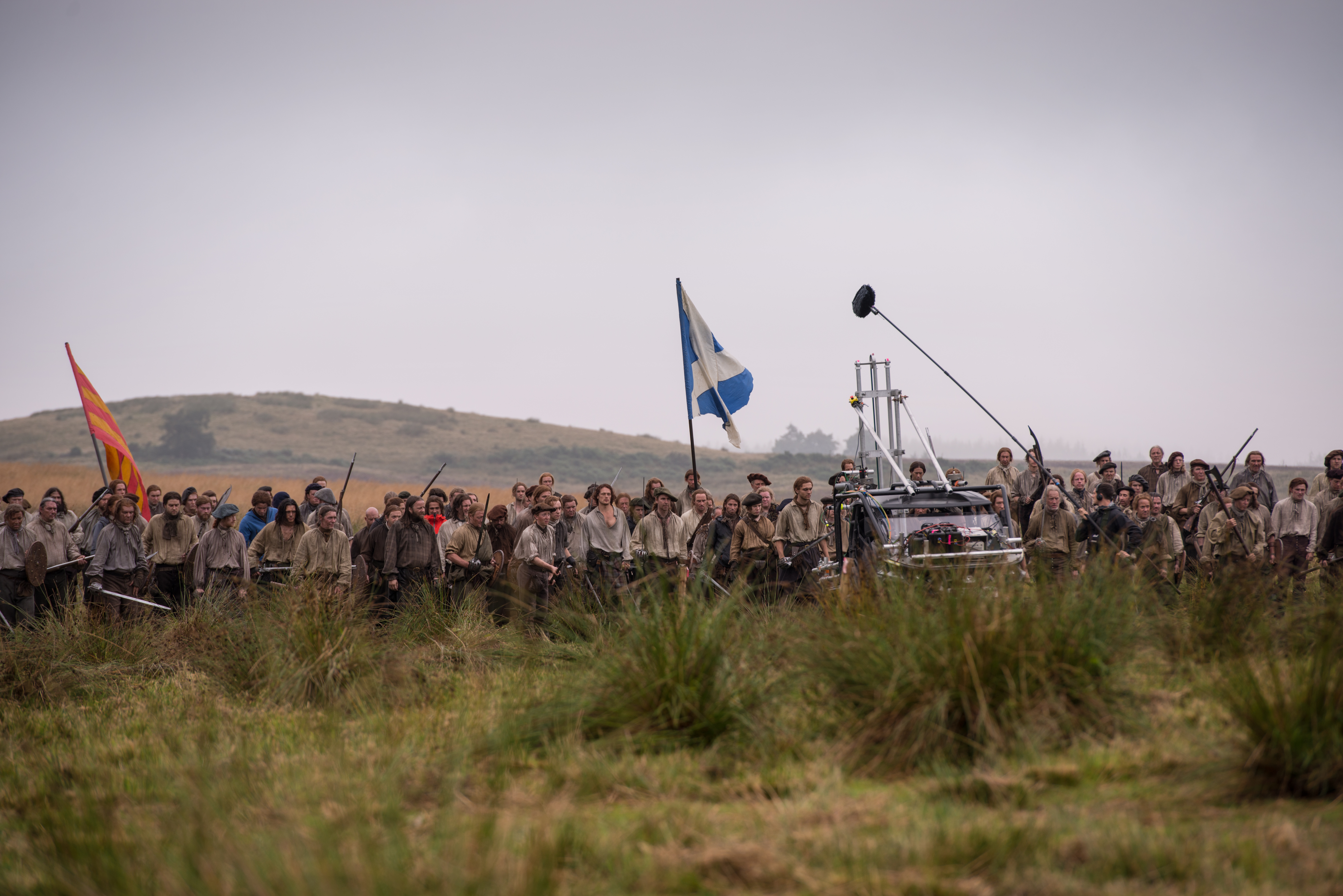 A camera vehicle maneuvers into position to capture the charge.