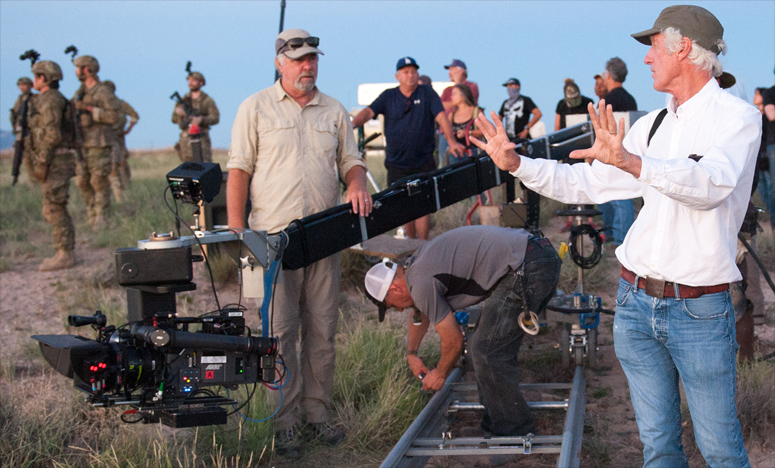 Roger Deakins sets up a shot with Key Grip Mitch Lillian on set of Sicario