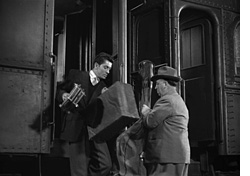 Strangers on a Train - HItchcock cameo at 10-36 -thefilmbook--