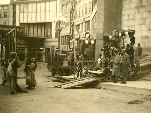Beginning of walking montage (Struss at left of dolly with notebook).