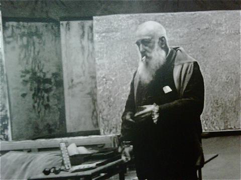 Monet in 1923, in his studio.
