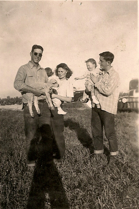 Left to right: Judy's father, Judy held by her mother, sister Jeanne with uncle Bert.