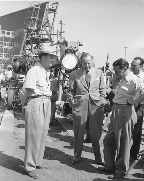 "From left: Director Richard Thorpe, producer Joe Pasternak and Harry Stradling, ASC, on the MGM lot. ""Obviously, something is wrong, and they're having a meeting about it,"" says Roy Wagner, ASC.  Everything's at a standstill. It's a rare photo showing a frustrated cinematographer. The pride of the cinematographer is what this photo is about."""