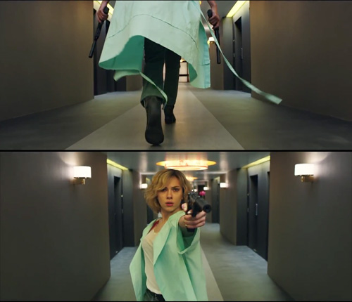 wearing the hospital gown in hotel hallway in Lucy-