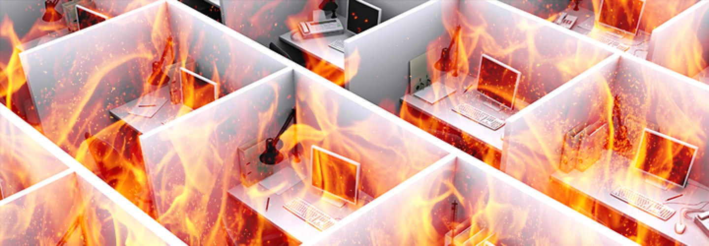 Office filled with cubicles that is on fire.