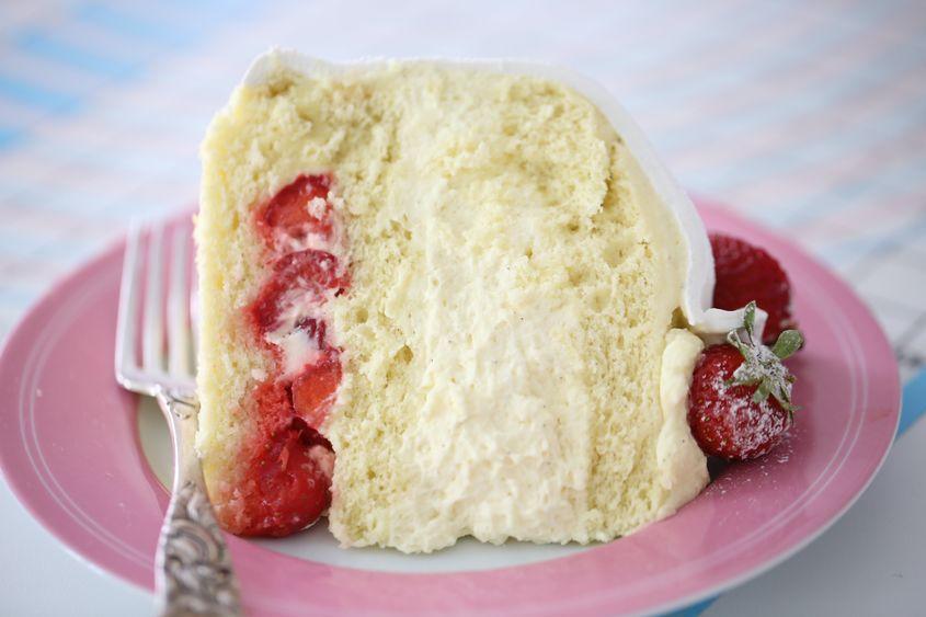 A slice of  White Strawberry Swedish Princess Cake