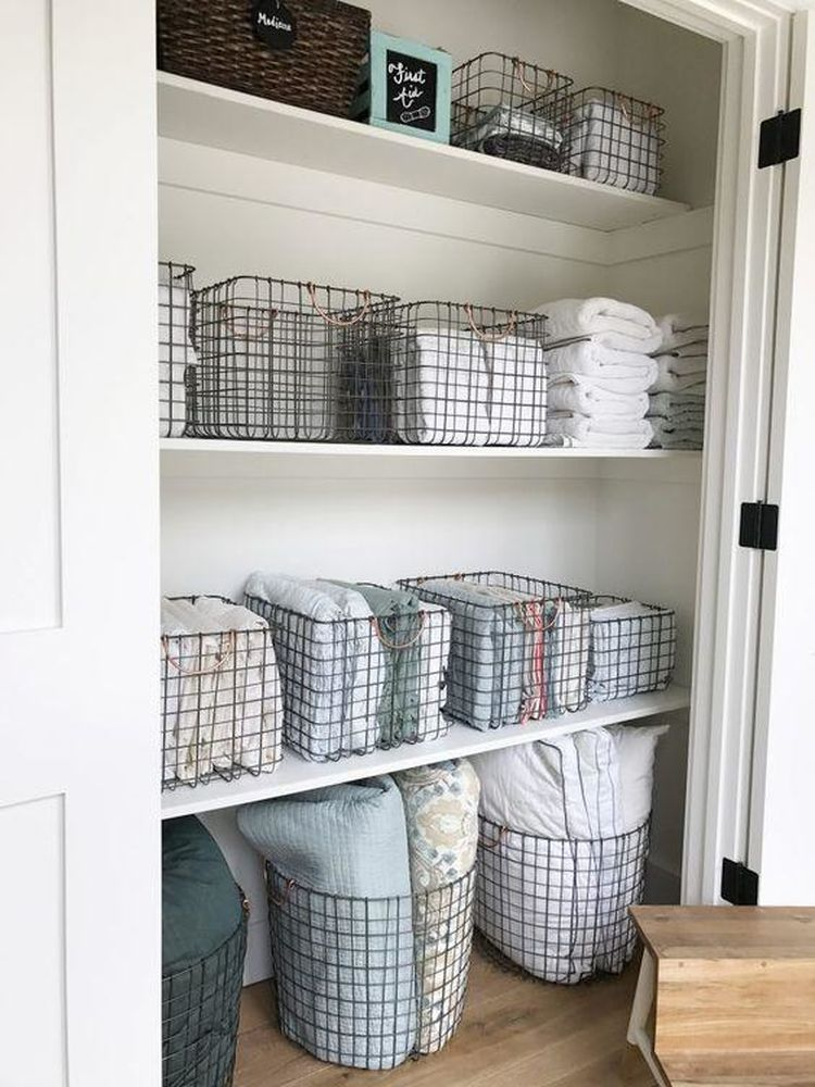 9 ways to organize your linen closet that ll make you feel for How do you organize your closet