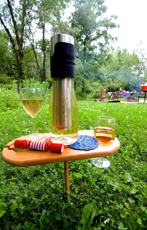 wine-and-nosh-table-with-campfire-background