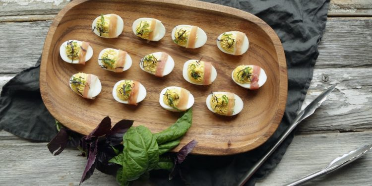 Roasted Garlic Deviled Eggs with Prosciutto + Basil
