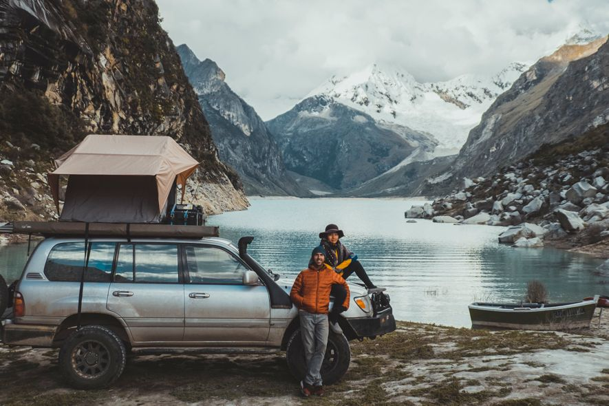 Smiling couple with camping car