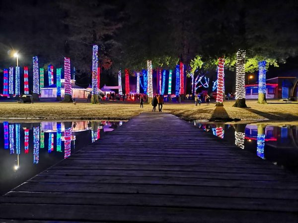 A couple walks walks through the Cultus lake Christmas lights