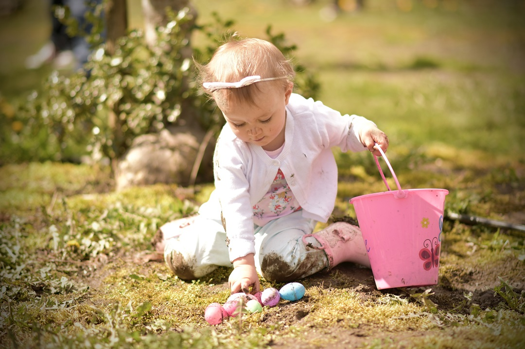 Child picking up eggs in an Easter event