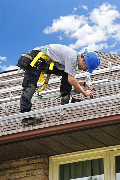 Bricklayer working with liability insurance