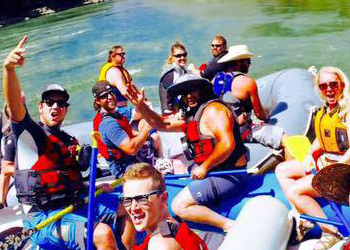 Scott Price group photo rafting down a river. Tranont Review: Our team does everything together.