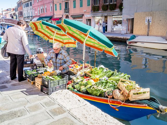 a small food boat in Murano