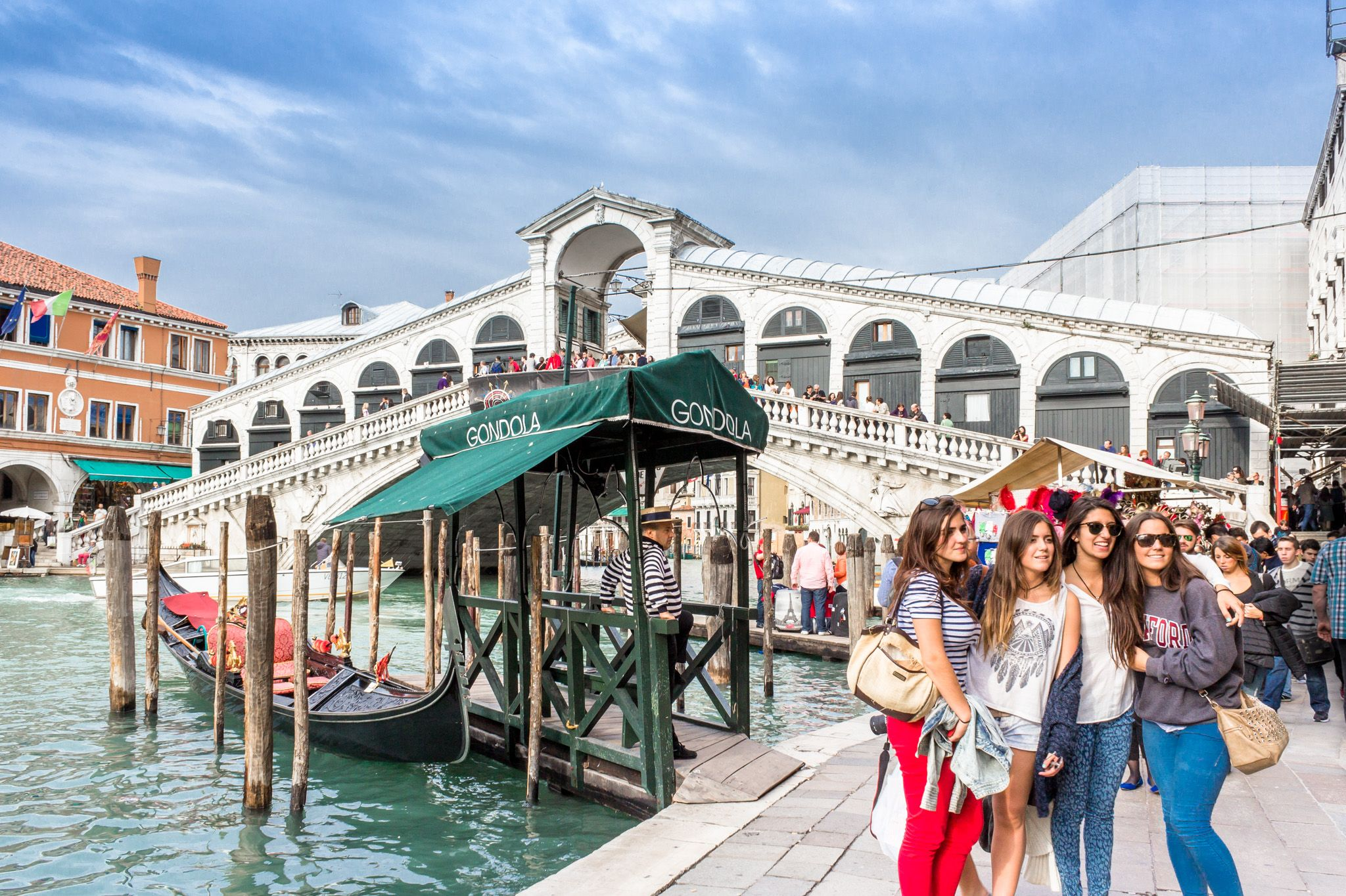 taking a photo by the Rialto Bridge and a Gondola stand