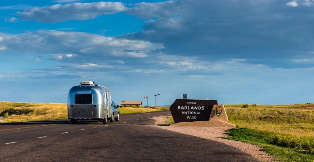 Car and Travel Trailer Entering Badlands National Park South Dakota