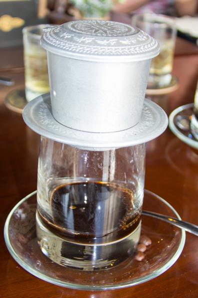 Vietnamese coffee perking in Trung Nguyen Legend coffee shop in Ho Chi Minh City in Vietnam