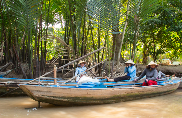 Sampons waiting for a fare on a tributary of the Mekong River, Vietnam