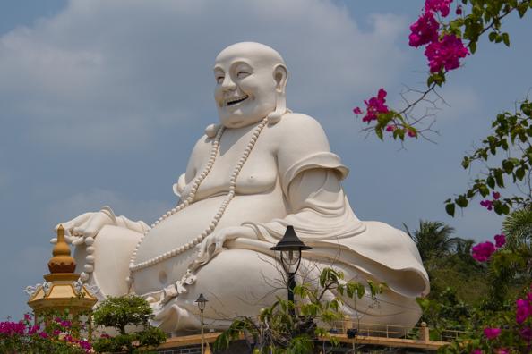 Giant laughing Buddha at Vinh Trang Pagoda, My Tho, Vietnam