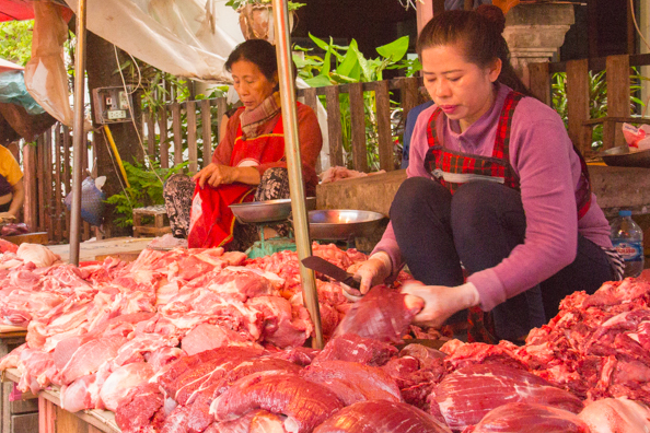 Fresh meat stalls at the morning market in Luang Prabang