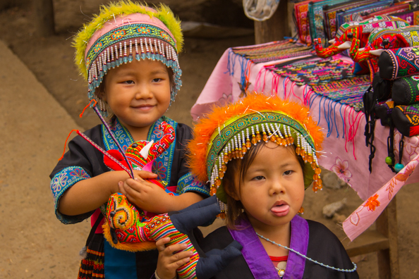 Children selling souvenirs in a Hmong village near Luang Prabang