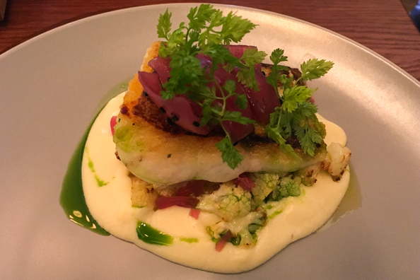 Pan-fried pike perch with cauliflower cream, marinated onions and chive oil at Leib Resto & Aed Restaurant in Tallinn, Estonia