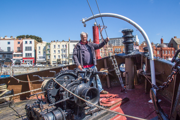 Michael on the steam tug Cervia in the Royal Harbour at Ramsgate, Thanet, Kent , UK