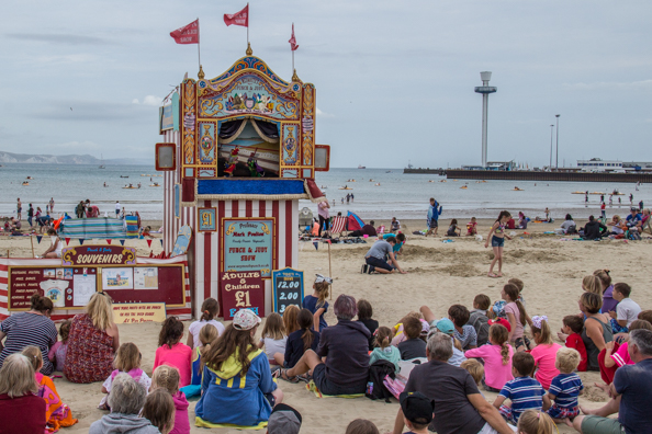 Punch and Judy on the beach in Weymouth on the Jurassic Coast in Dorset, UK
