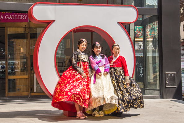 Traditional Korean costumes in a modern setting - Insadong Antique Alley in Seoul, South Korea