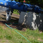 Figure 2. Garden hose attached to filtration system. Photo credit WTFRC.