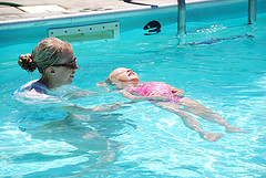 child swimming lesson back float
