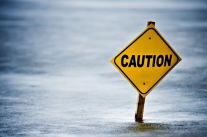 Caution sign in water
