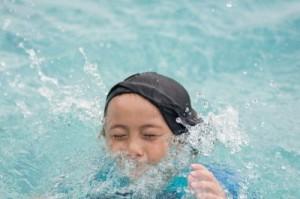 child swimming bobs
