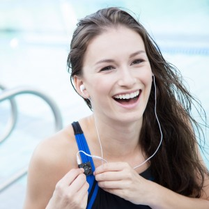 Wearing waterproof ipod Swimbud Bundle. Short-Cord clips to swimsuit