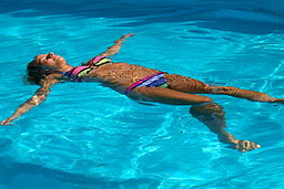 woman in swimming pool floatiing