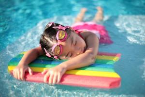 girl swimming foam board