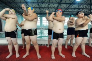 swimmer boys stretching