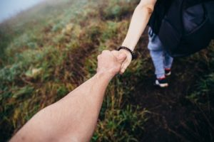 holding hands to indicate support