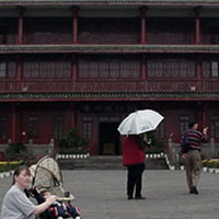 Wife and child and classic Chinese architecture.