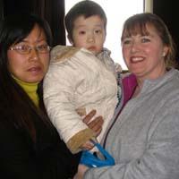 Ma ma, Olivia and the orphanage director.