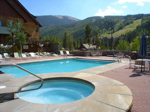 Outdoor heated pool and hot tubs just steps from the unit