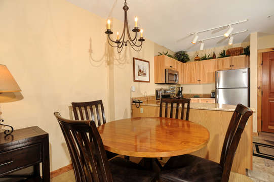 Fully equipped kitchen with adjacent dining table seating 4