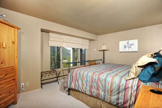 Master Bedroom has sweeping lake and mountain views