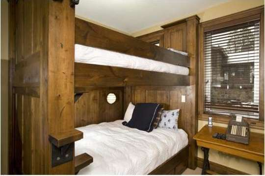 Bunk Room with 2 sets of Queen bunks, each with a private flat screen TV