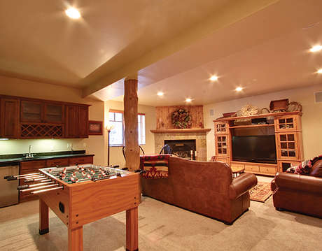 Downstairs Family Room with fireplace, wet bar, foosball, large screen TV entertainment center, card table