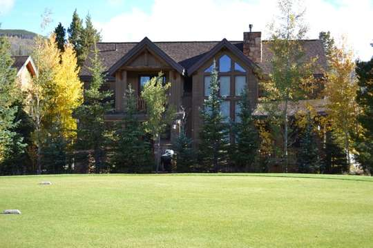 View of back side of house from golf course