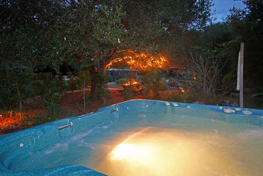 Hot tub with nearby fountain
