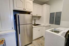 Laundry room with backup fridge