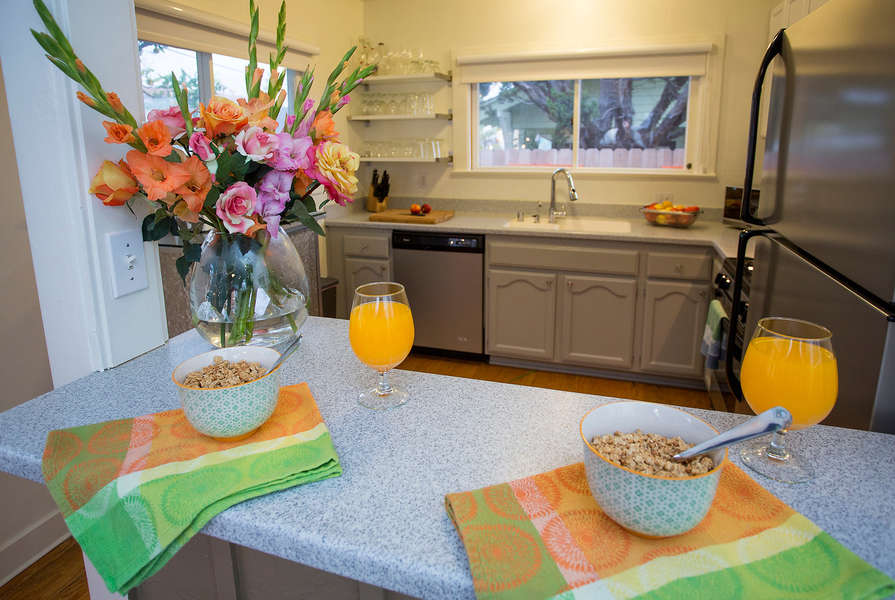 Breakfast Bar overlooks meal prep in the Kitchen